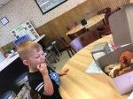 little boy eatingdonut